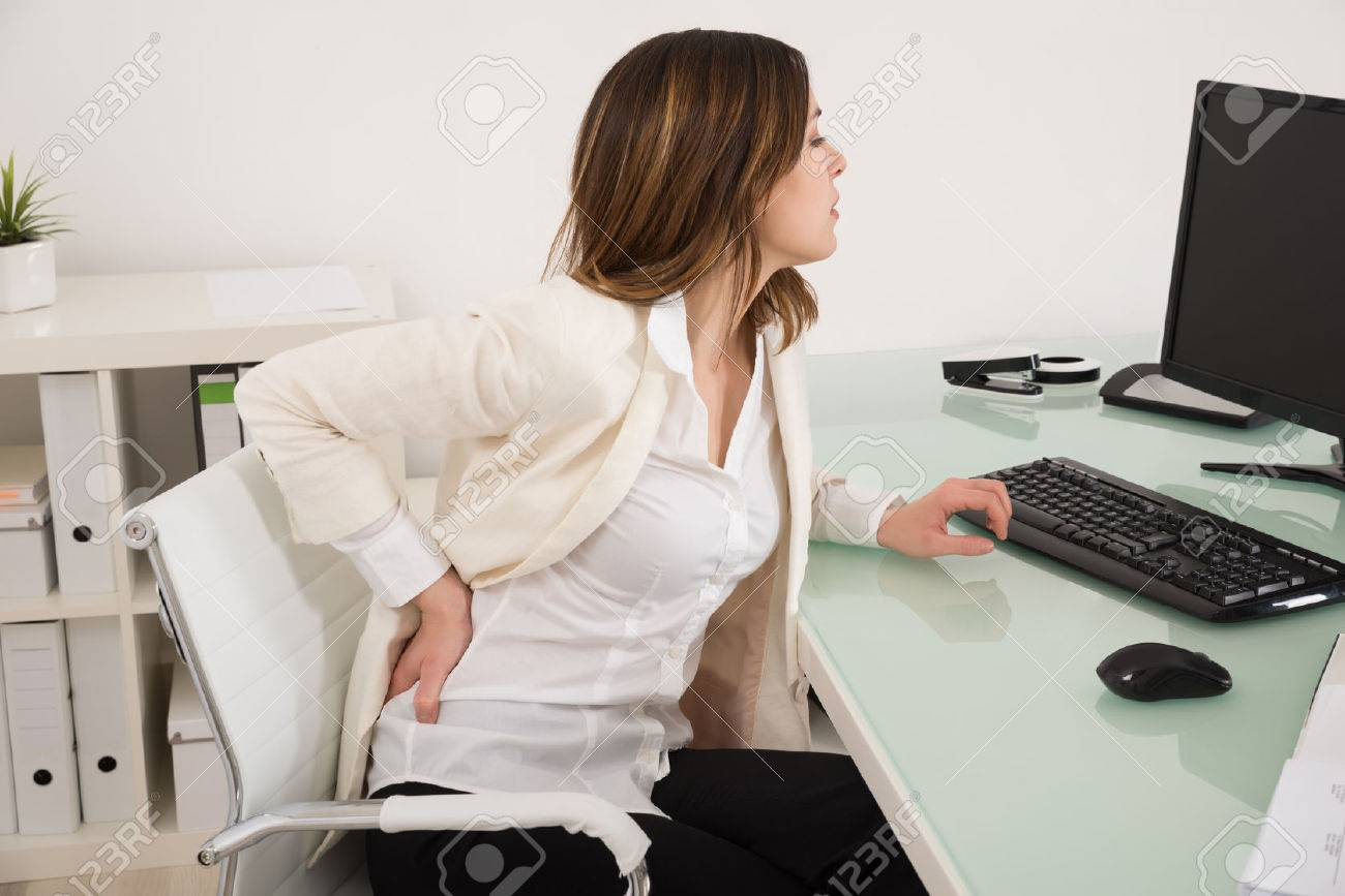 Young Businesswoman Suffering From Backache In Office - 52951799