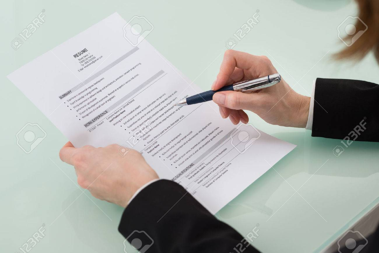 Close Up Photo Of Person Hand Holding Resume Stock Photo Picture
