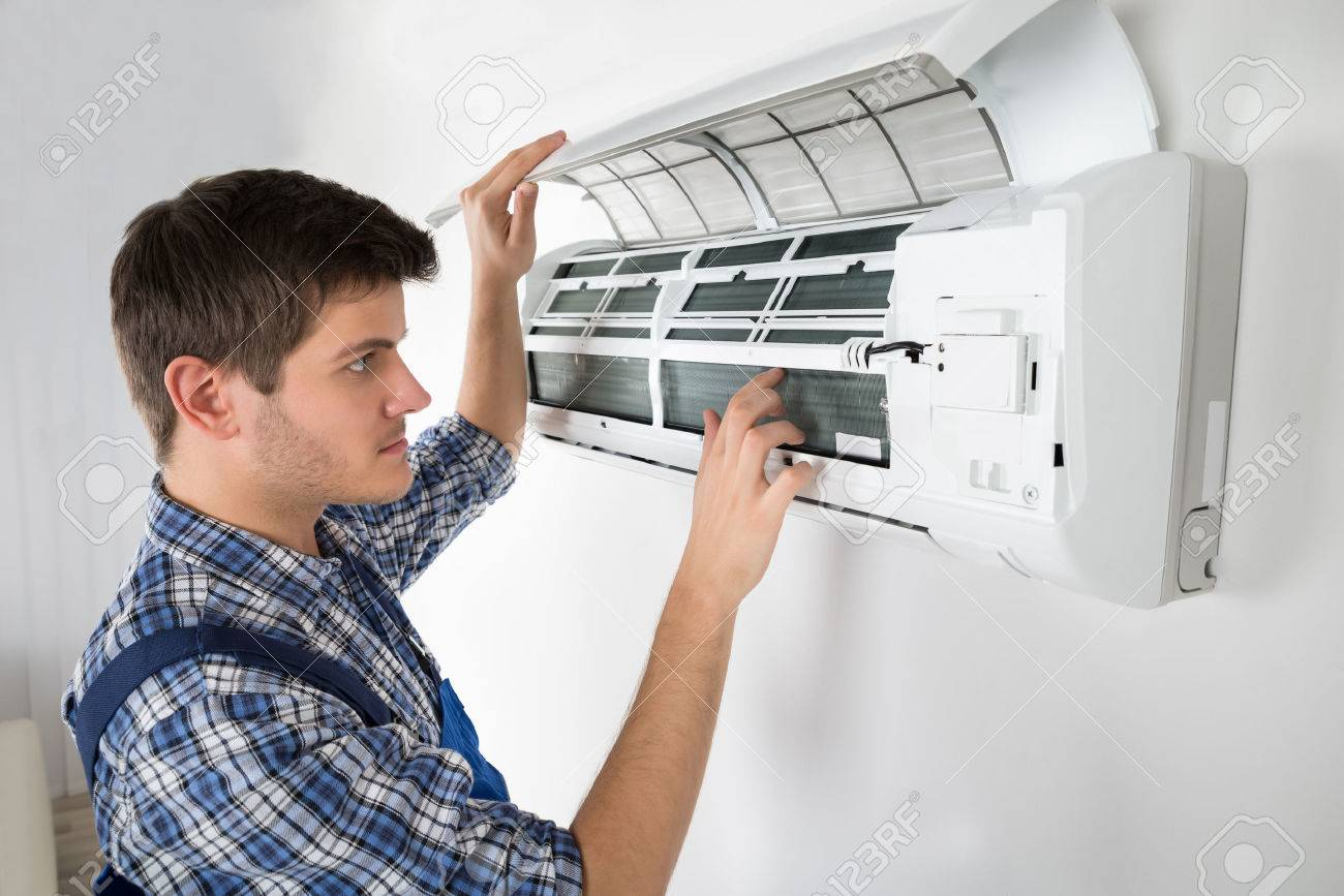 Photo Of Young Male Technician Repairing Air Conditioner - 54885623