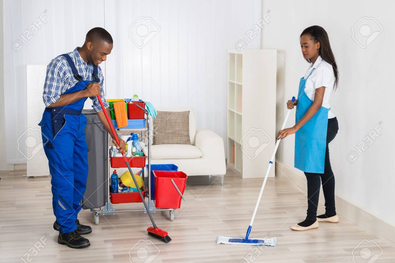 Photo Of Two Professional Janitors Cleaning Apartment Stock Photo   56064826