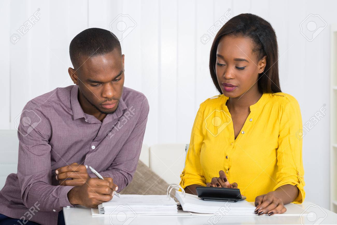 Photo Of Young Couple Calculating Bill At Home - 56278488