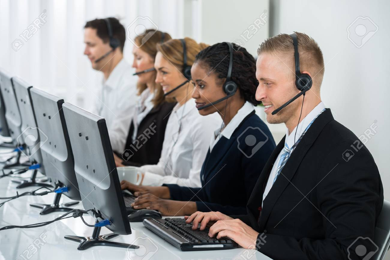 Team Of Businesspeople With Headsets Working In Call Center Office - 57105680
