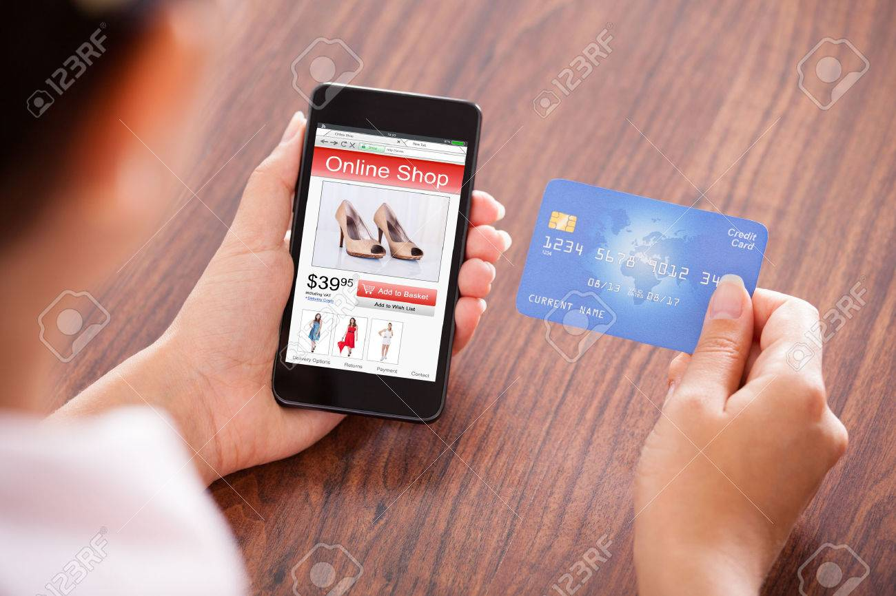 ce82f6cac2f Close-up Of Businessperson With Mobile Phone Showing Online Shopping  Application And Credit Card Stock