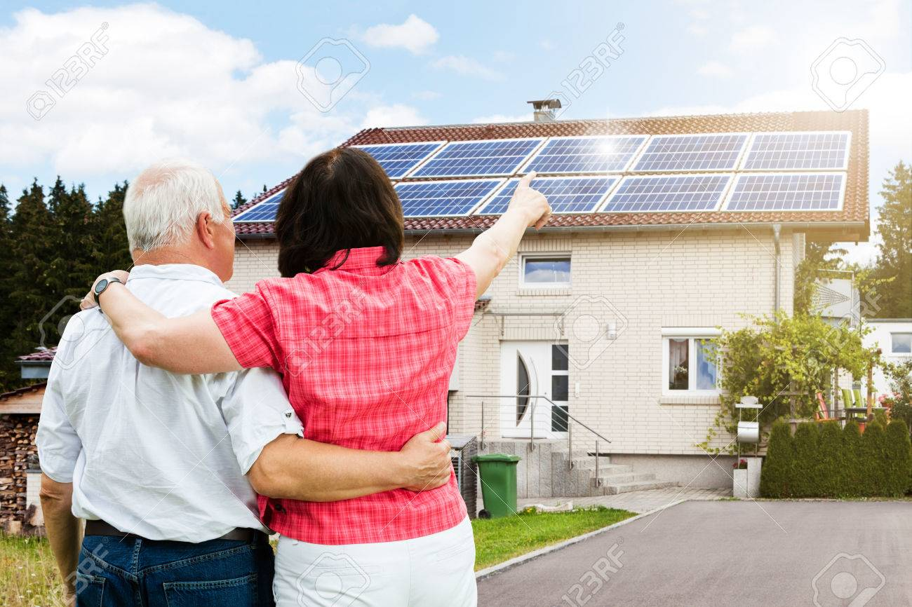 Rear View Of Senior Couple Pointing Finger In Front Of House - 64951109