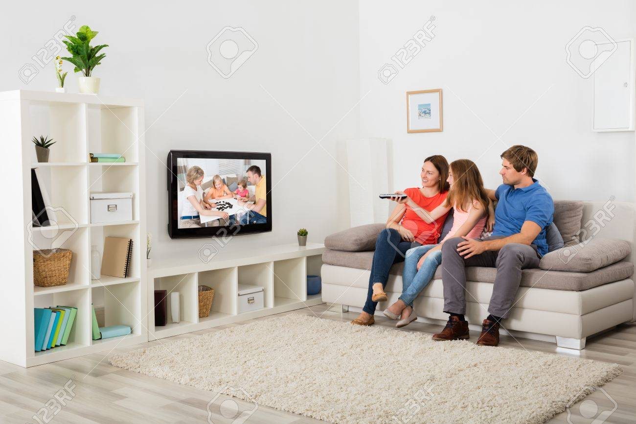 Living Room With Tv And People looking tv images & stock pictures. royalty free looking tv photos