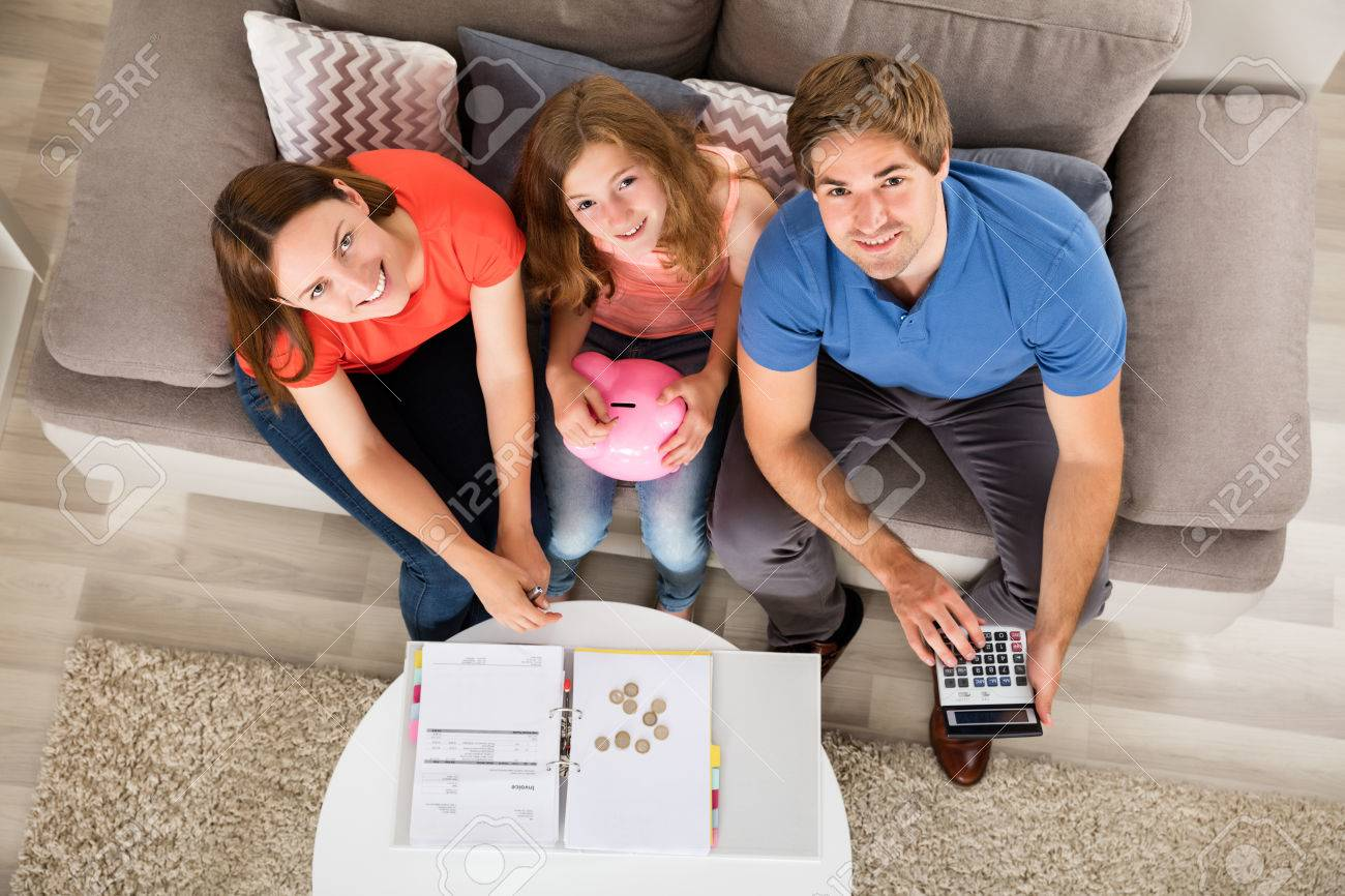 High Angle View Of A Smiling Family Calculating Tax Standard-Bild - 63937793
