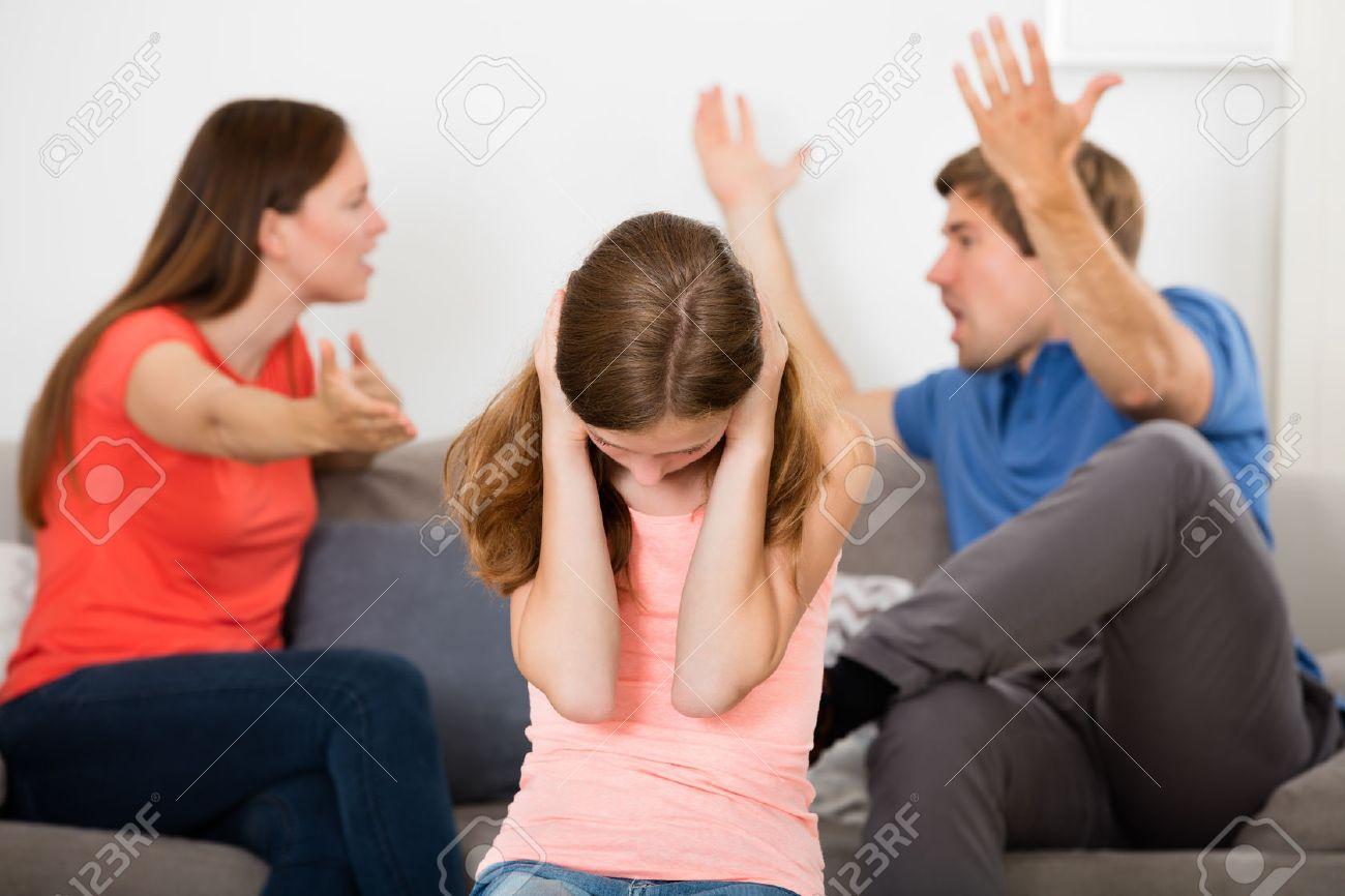 Upset Girl Covering Her Ears In Front Of Parent Having Argument Standard-Bild - 63938332