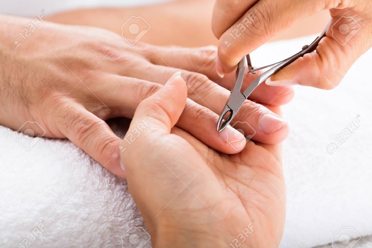 Close-up Of A Manicurist Cutting Off The Cuticle From The Person\'s ...