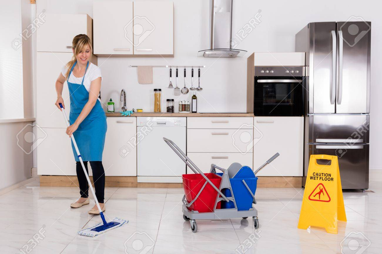 Cleaning Service Janitor Using Mop To Clean Kitchen Floor Stock Photo    69331815