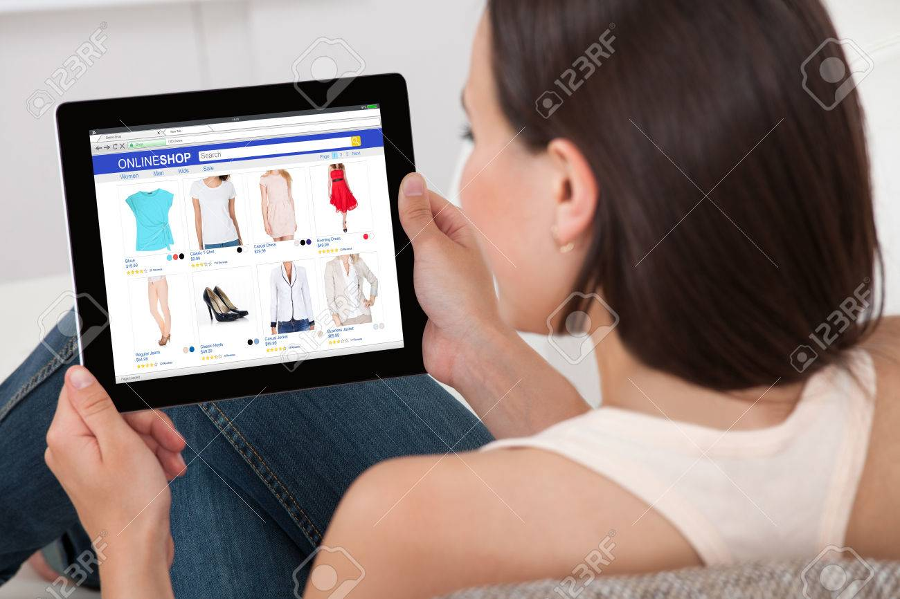 Close-up Of Woman Doing Online Shopping On Digital Tablet At Home Standard-Bild - 69611458