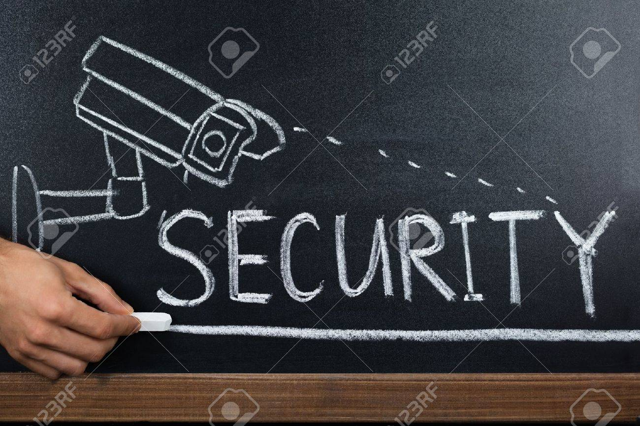 Close-up Of A Person Hand Showing Security Concept On Blackboard Banque d'images - 70308548