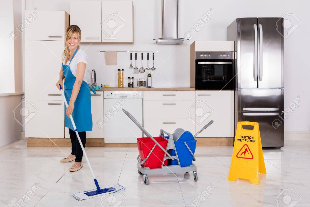 Cleaning Service Maid Using Mop To Clean Kitchen Floor Stock Photo    70308367
