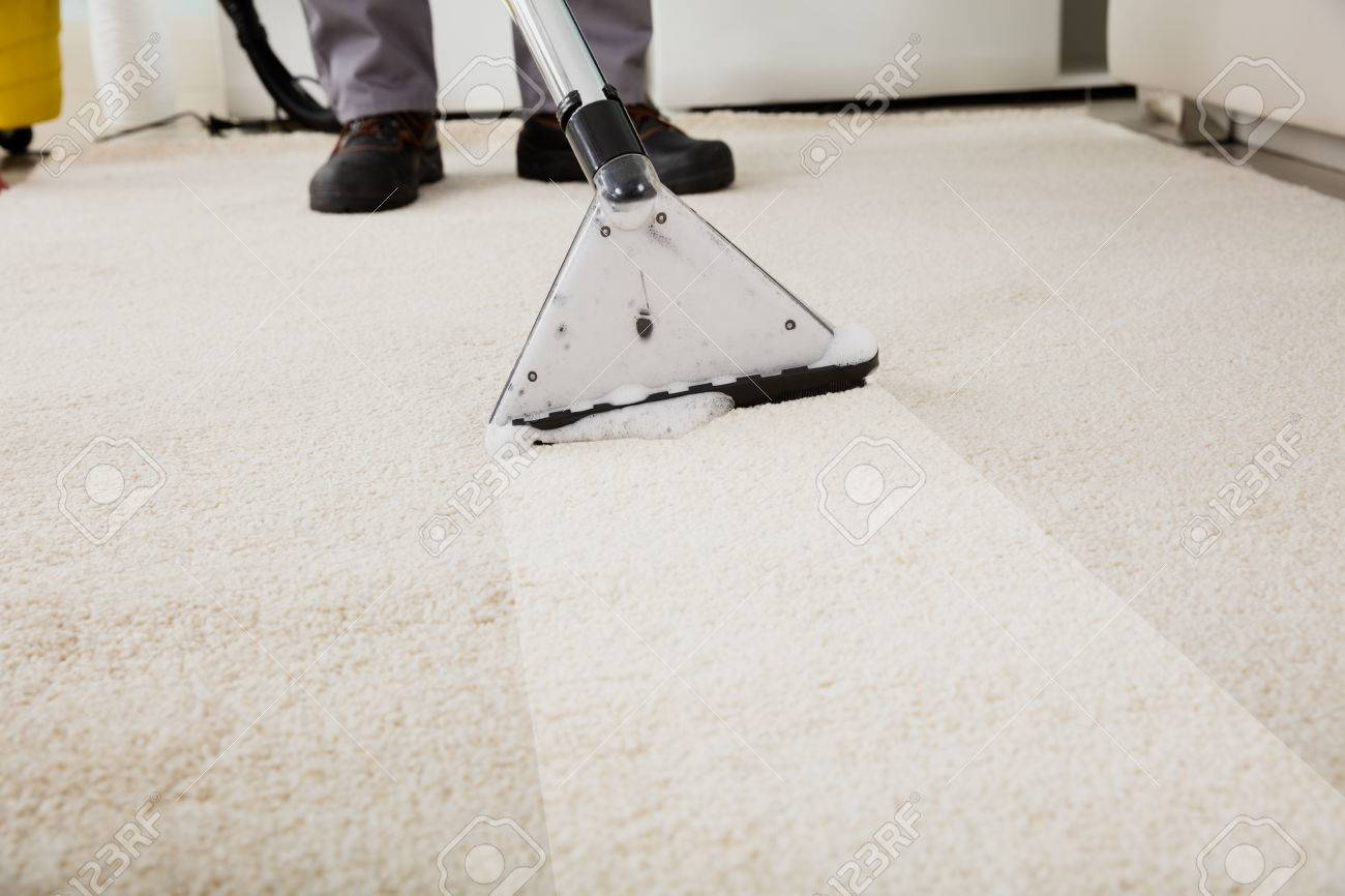 Close-up Of A Person Cleaning Carpet With Vacuum Cleaner Standard-Bild - 70448673