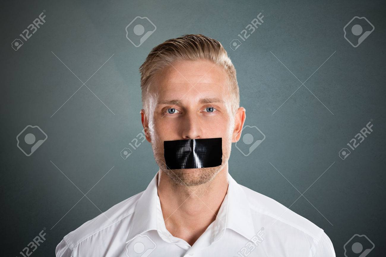 Young Man With Black Duct Tape Over His Mouth Against Grey Background - 70449249