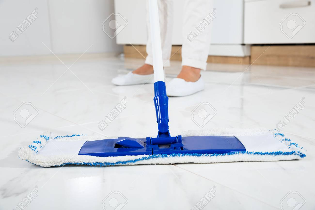 Cleaning Service Woman Mopping The Floor In Kitchen At Home Stock ...