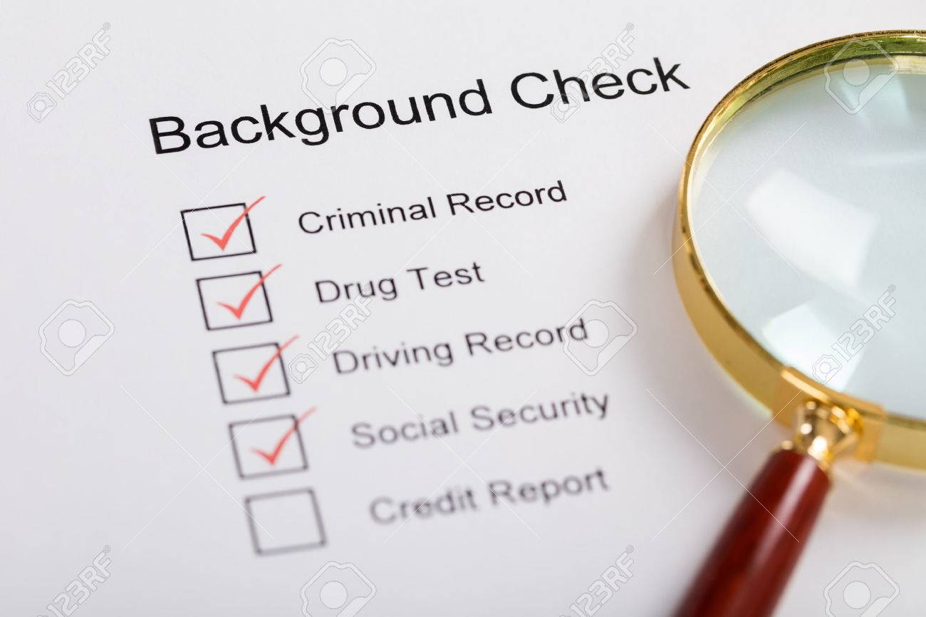High Angle View Of Magnifying Glass Over Background Check Form Standard-Bild - 70454390