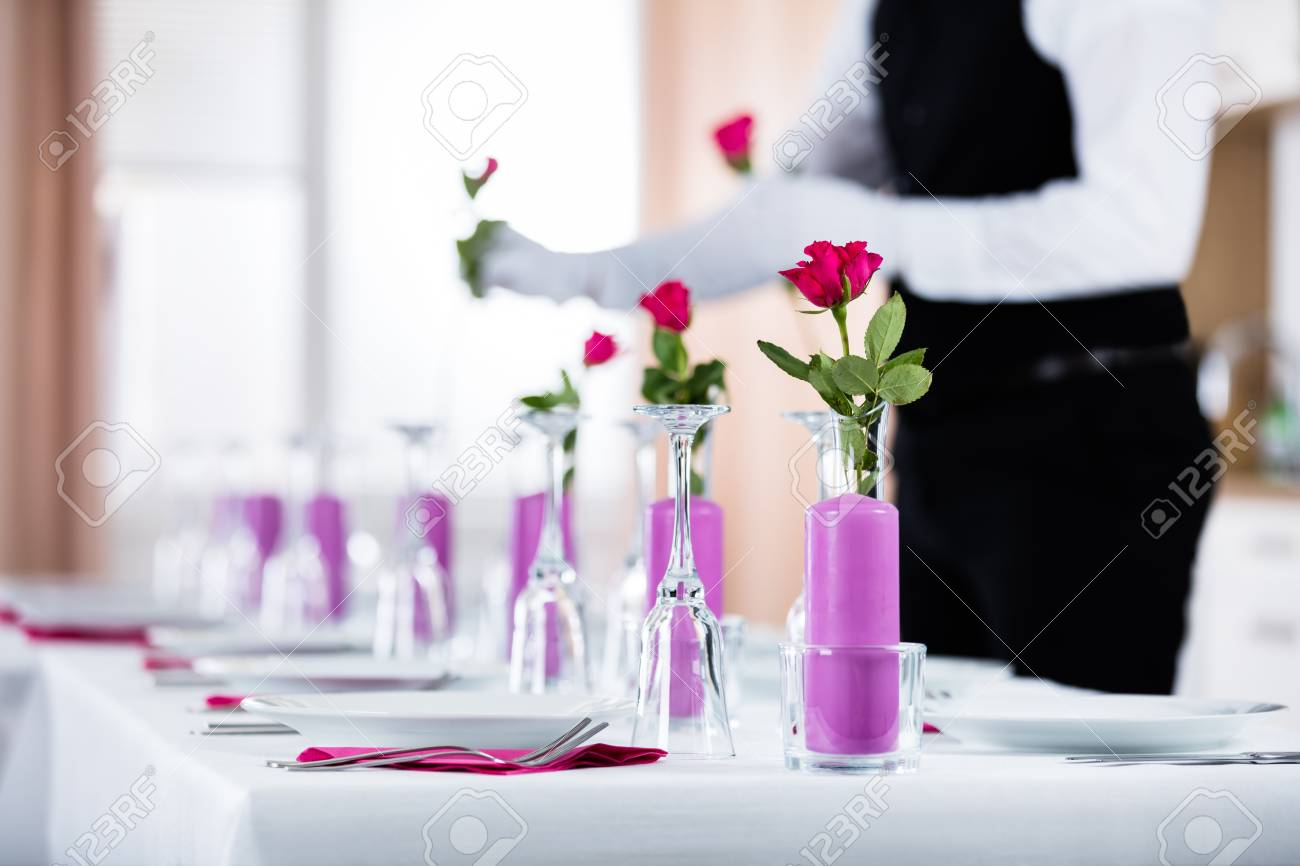 Close up of waiter arranging roses in vase on wedding table stock close up of waiter arranging roses in vase on wedding table stock photo 70824503 reviewsmspy