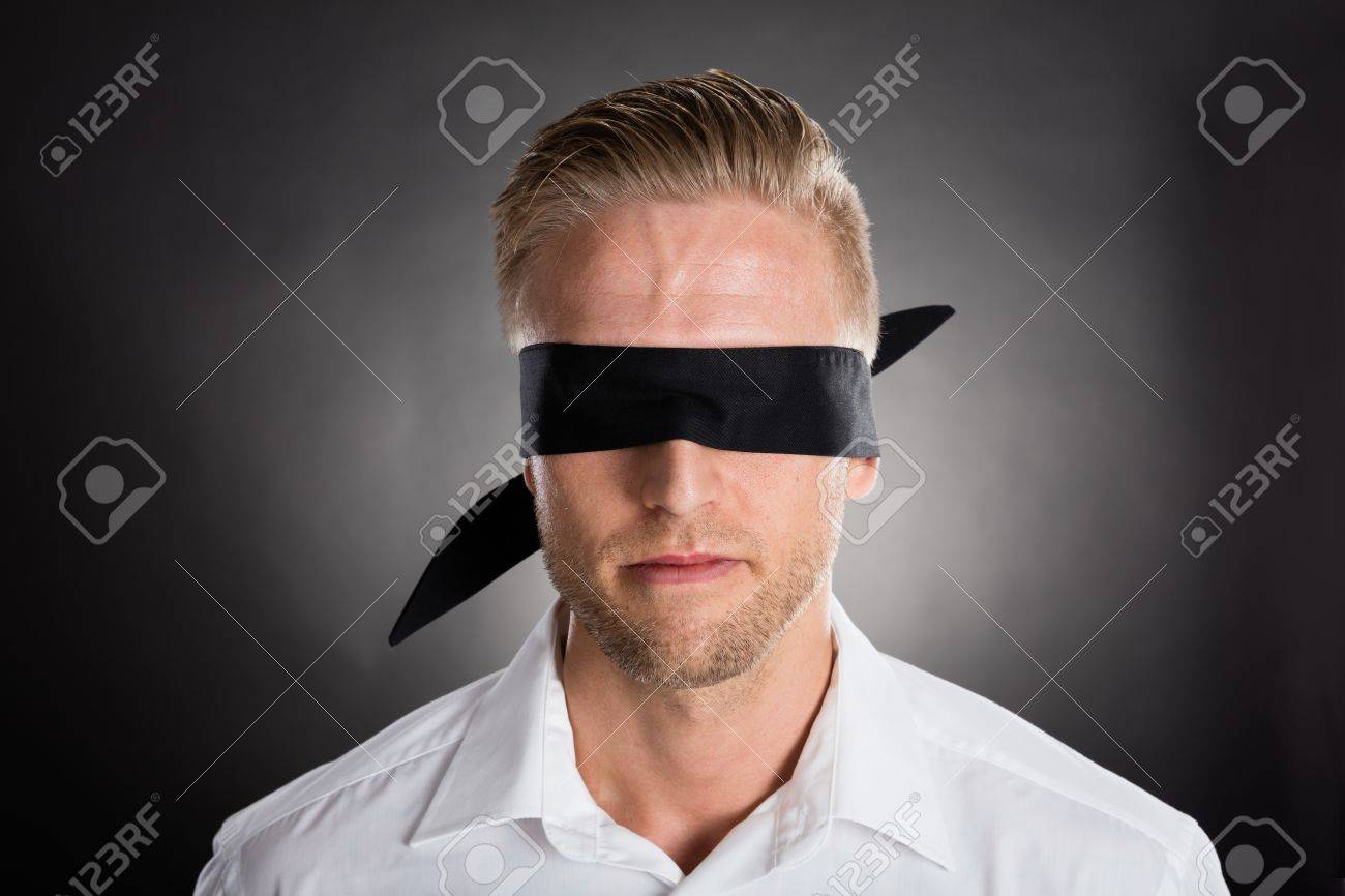 e6202468ee1 Stock Photo - Young Lost Businessman With A Black Blindfold