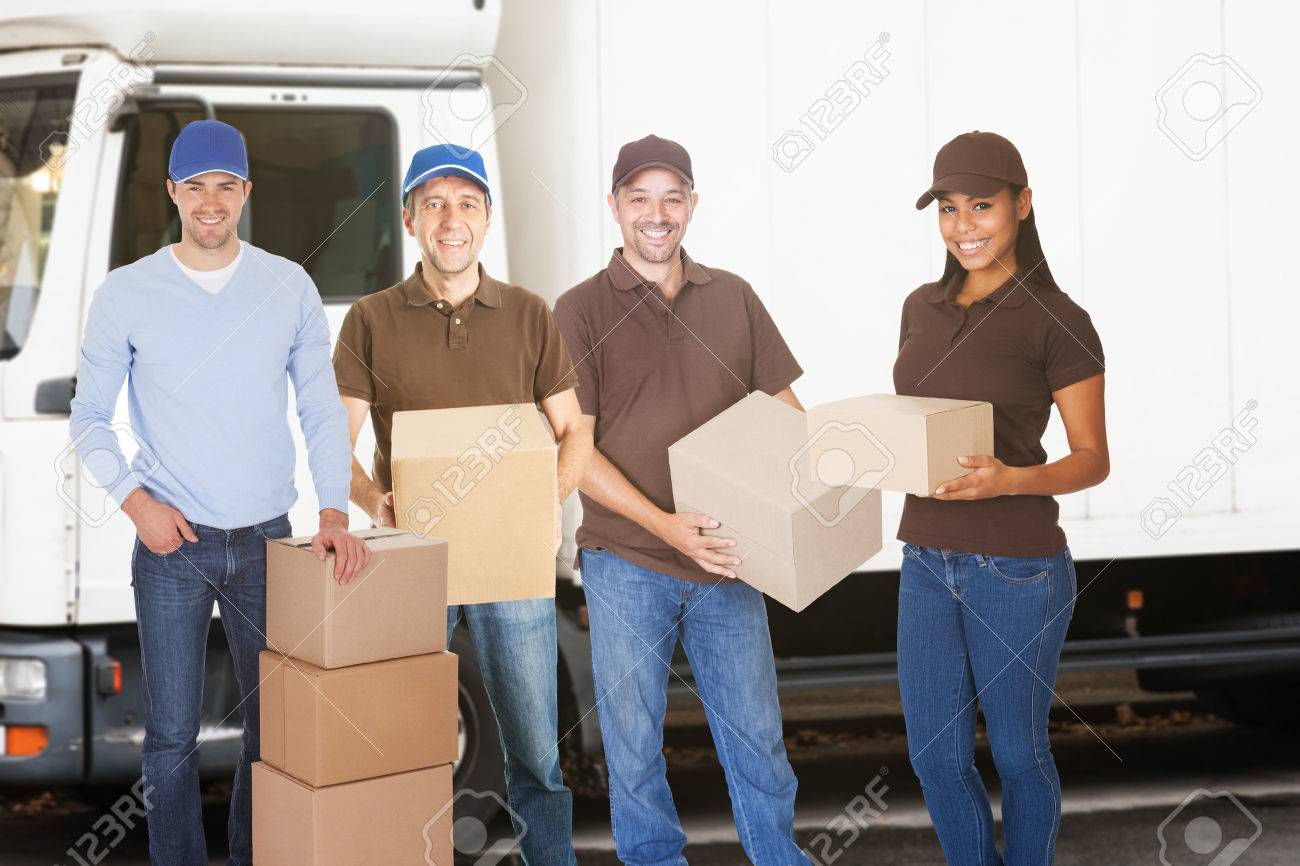 Group Of Delivery And Furniture Movers People Standing With Boxes