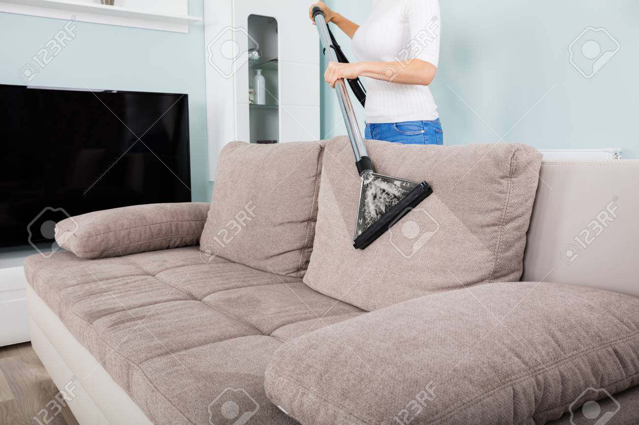 Woman Closeup Cleaning At Home Vacuum With Sofa Cleaner Of pVGLjqSzMU