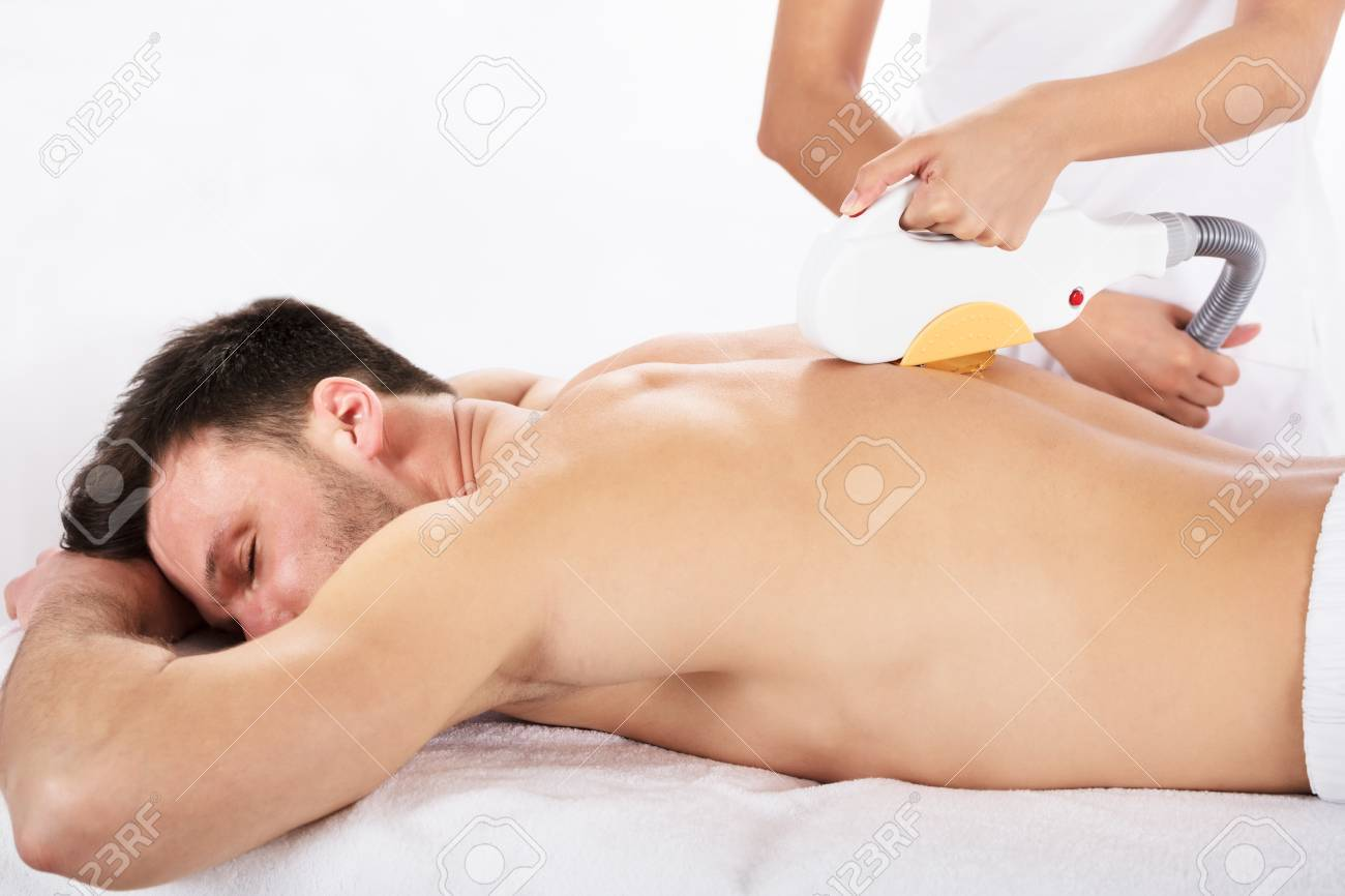 Hair Removal Cosmetology Procedure From A Therapist At Cosmetic Beauty Spa Clinic Standard-Bild - 77931295
