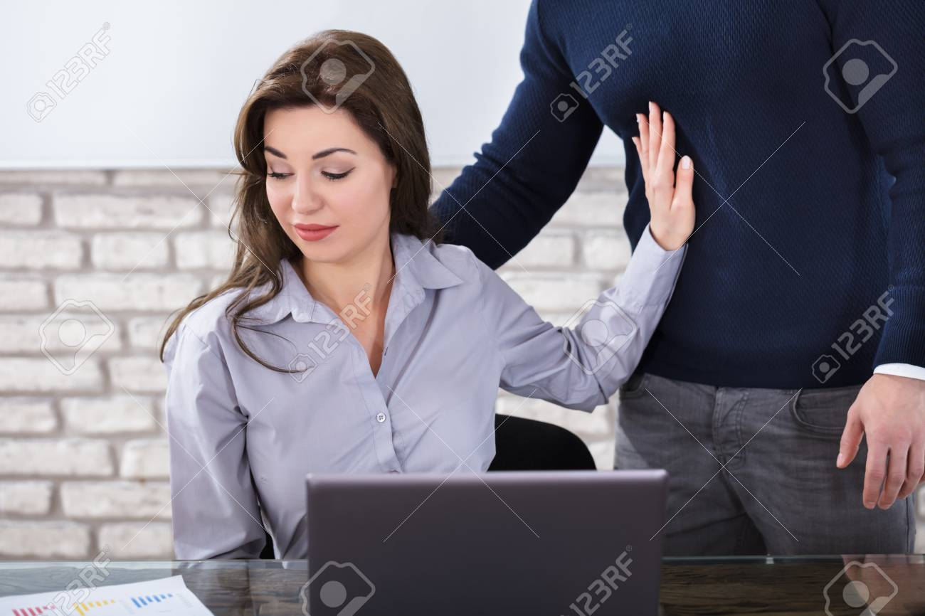 Young Woman Defending Herself For Sexual Harassment In Business Office - 82969290