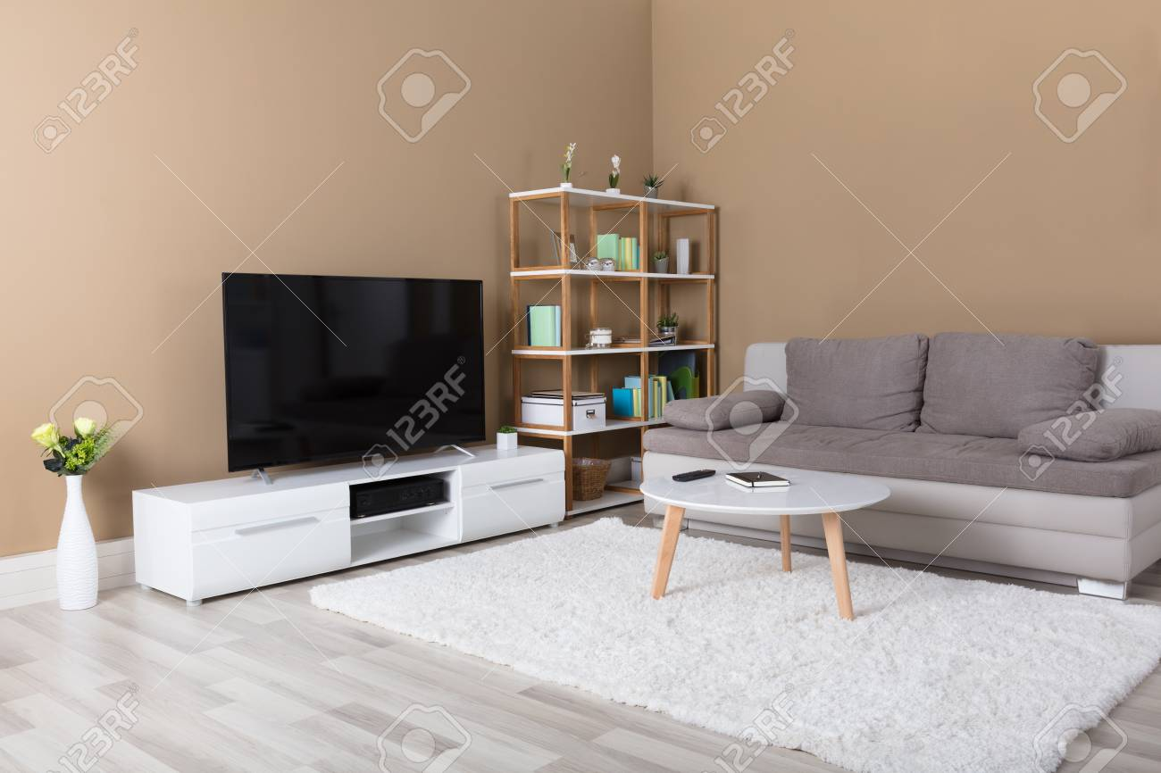 Modern Apartment With Television And Sofa In Living Room Stock Photo ...