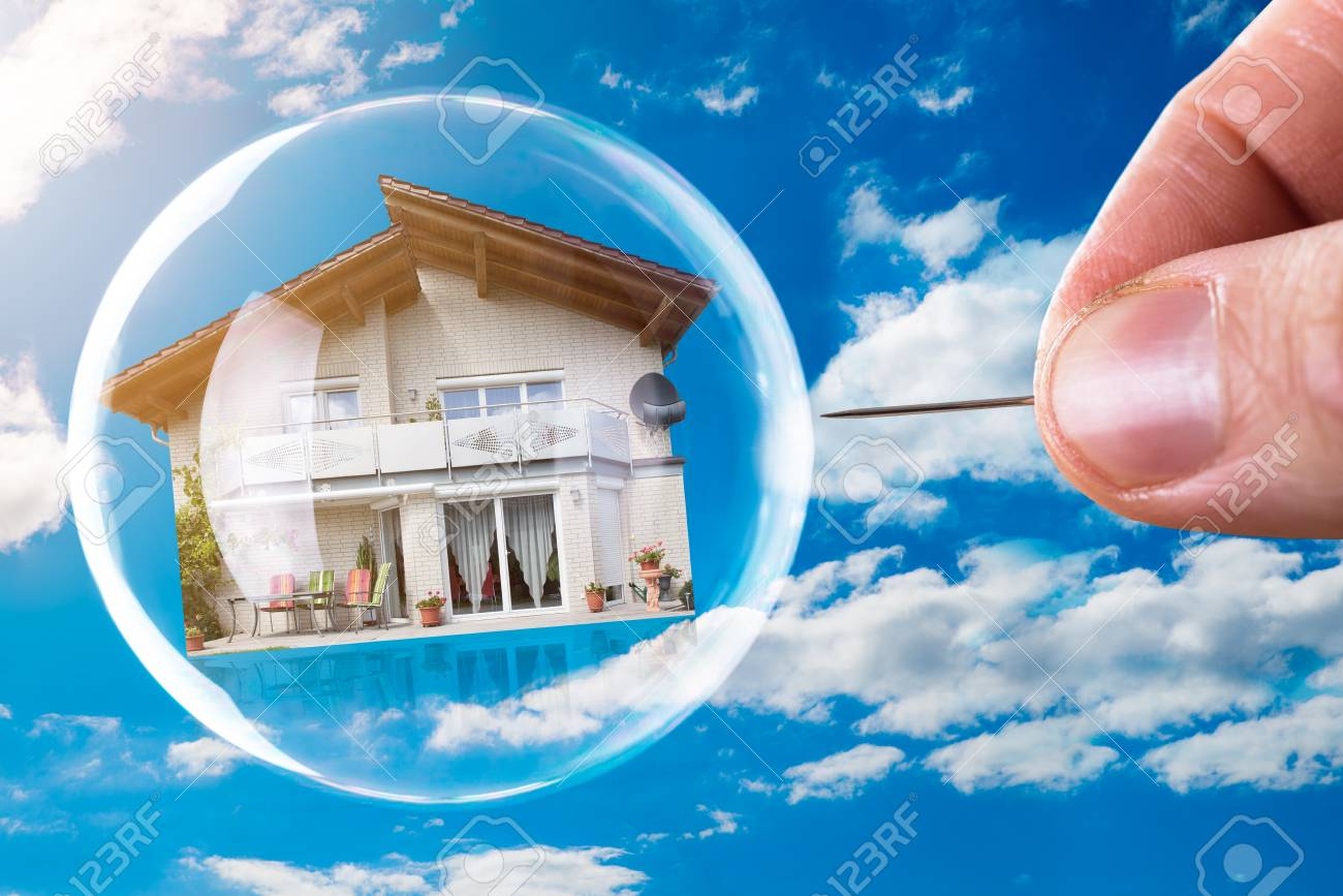 Human Hand Poking House And Bubble With Needle Against Cloudy Sky - 92344430