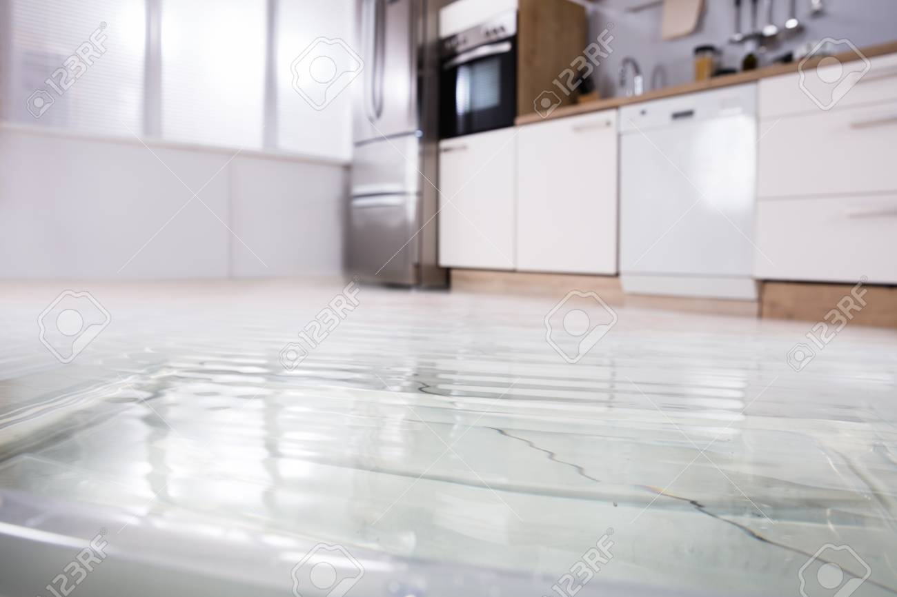 Close-up Photo Of Flooded Floor In Kitchen From Water Leak Stock ...