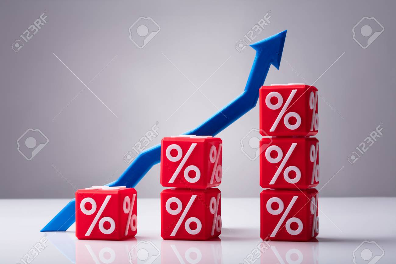 Increasing Stacked Red Cubes With Percentage Symbol And Blue Arrow Showing Upward Direction - 103551756