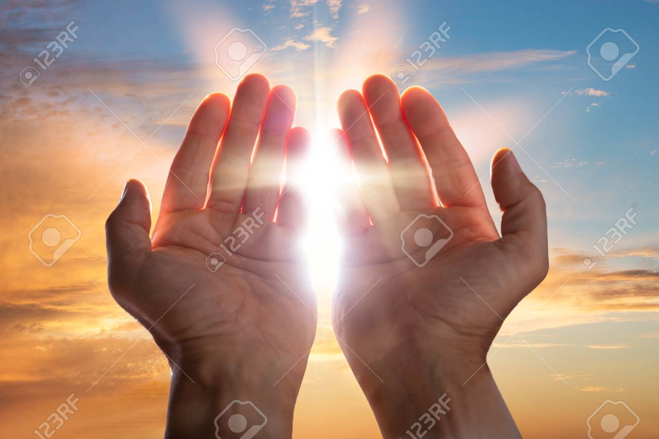 Close-up Of A Praying Hands With Sunlight - 107215996