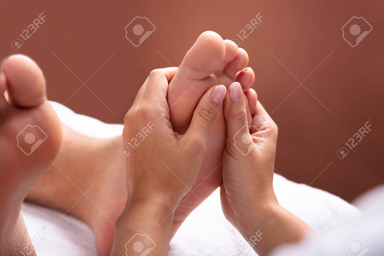 Close-up Of Therapist Hand Giving Foot Massage To Man - 113242169