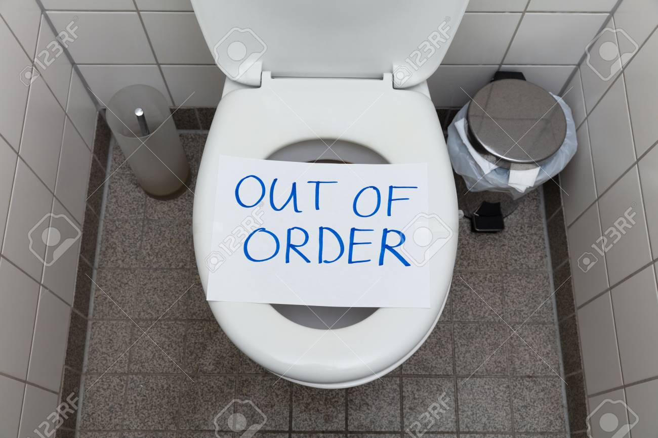 Written Text Out Of Order Message On Paper Over Toilet Bowl In Bathroom - 121138920