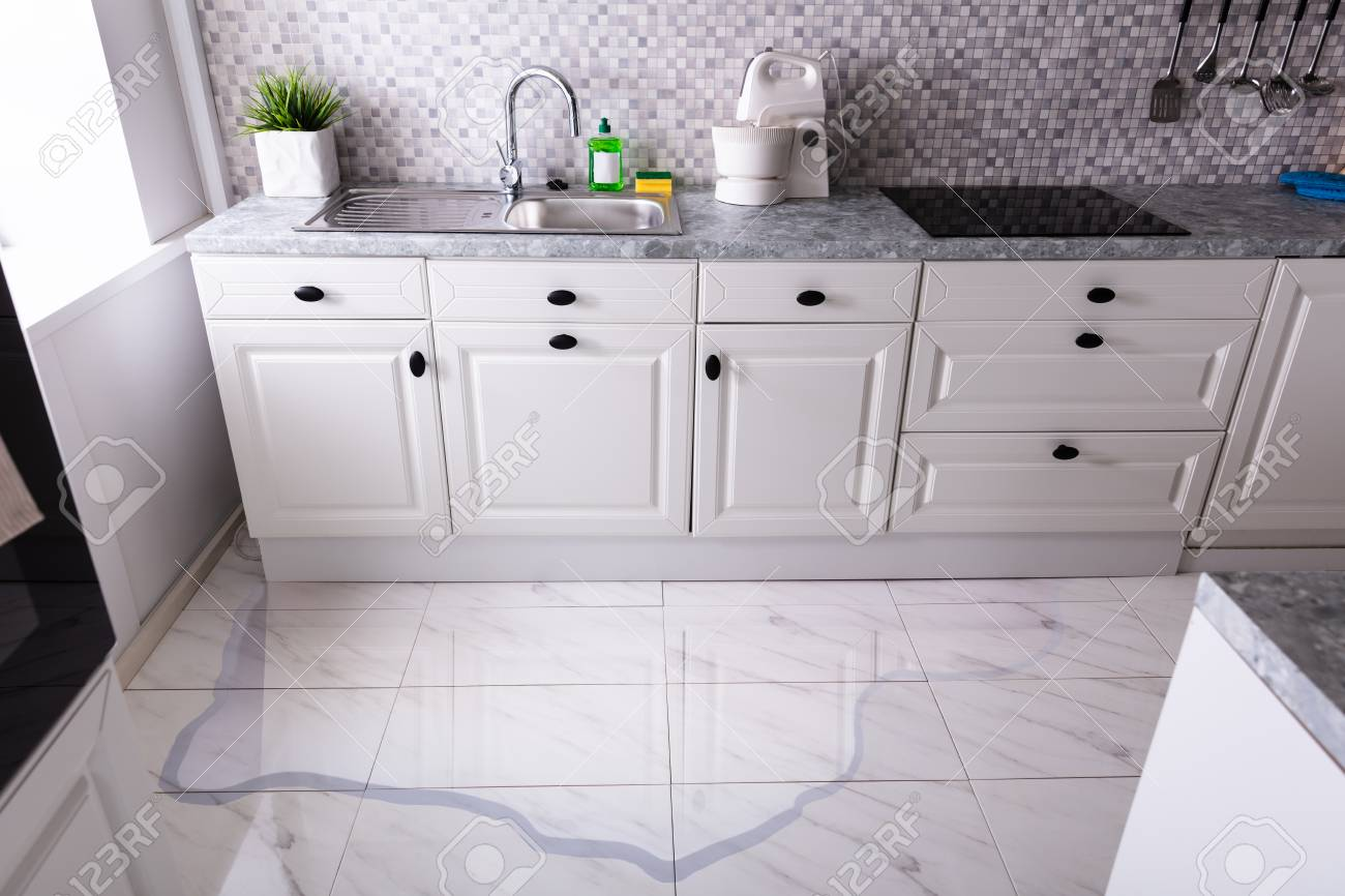 Close up Of Spilled Water On Kitchen Floor At Home