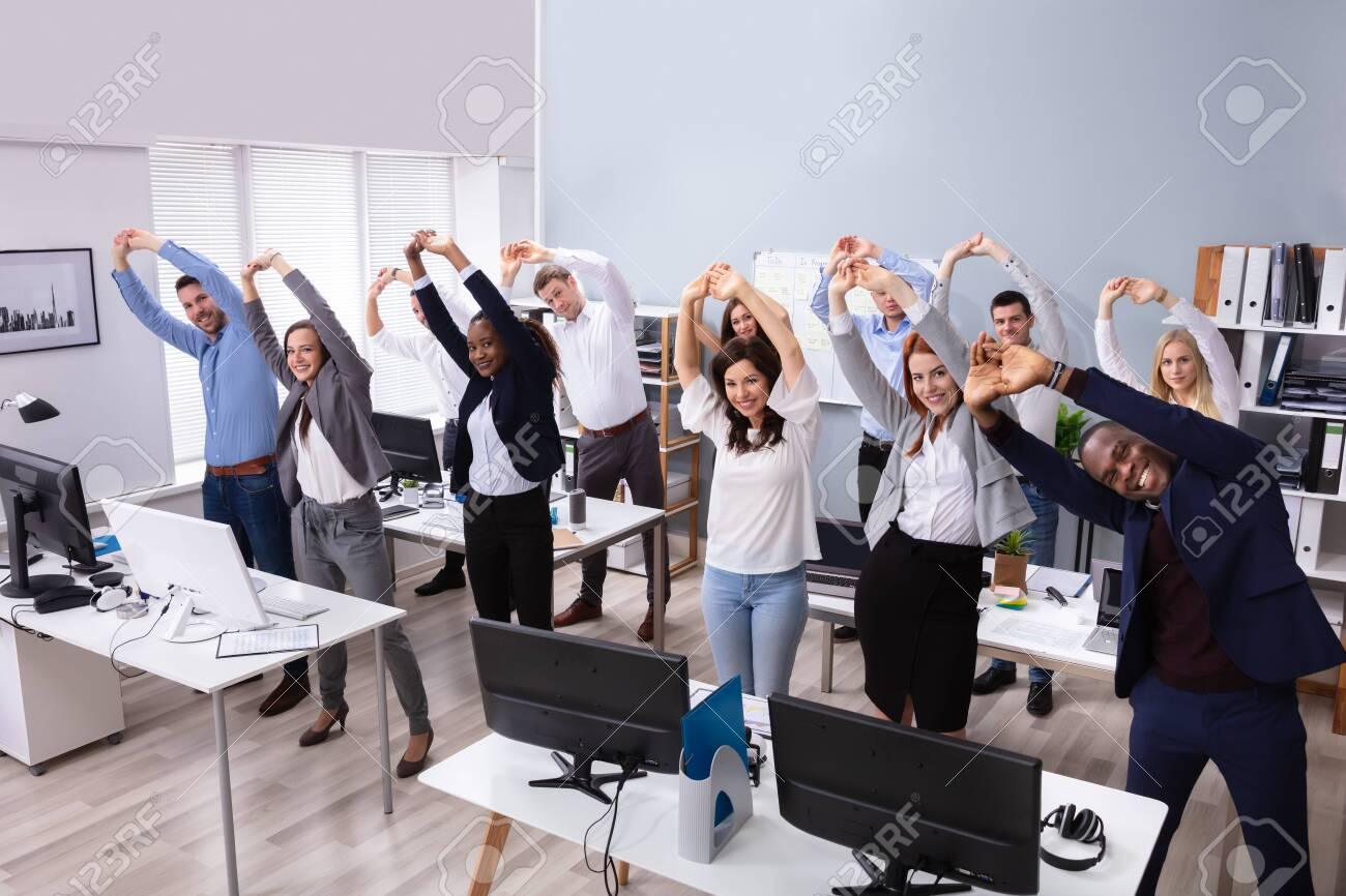 Group Of Smiling Multi-ethnic Businesspeople Doing Stretching Exercise At Workplace - 123419040