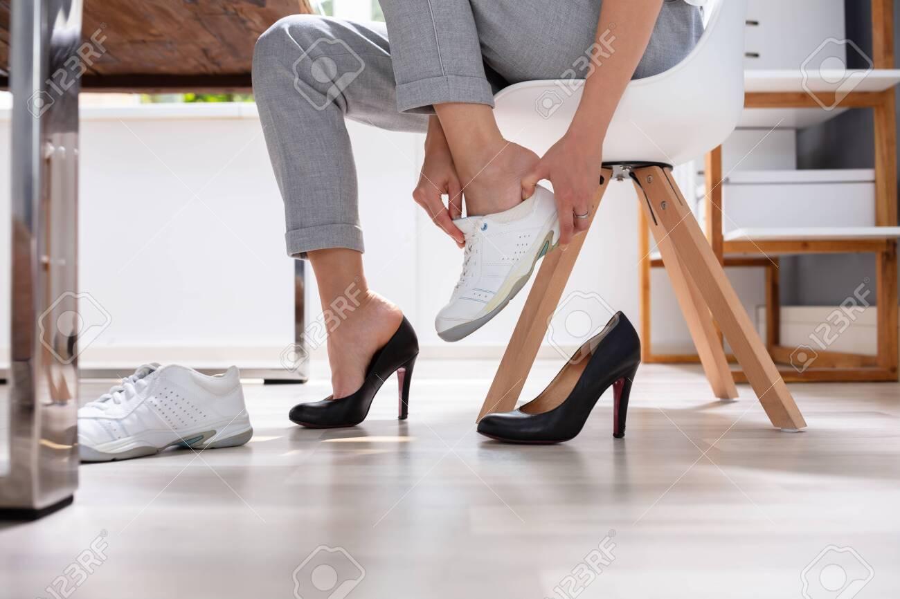 Businesswoman Removes Black Shoes