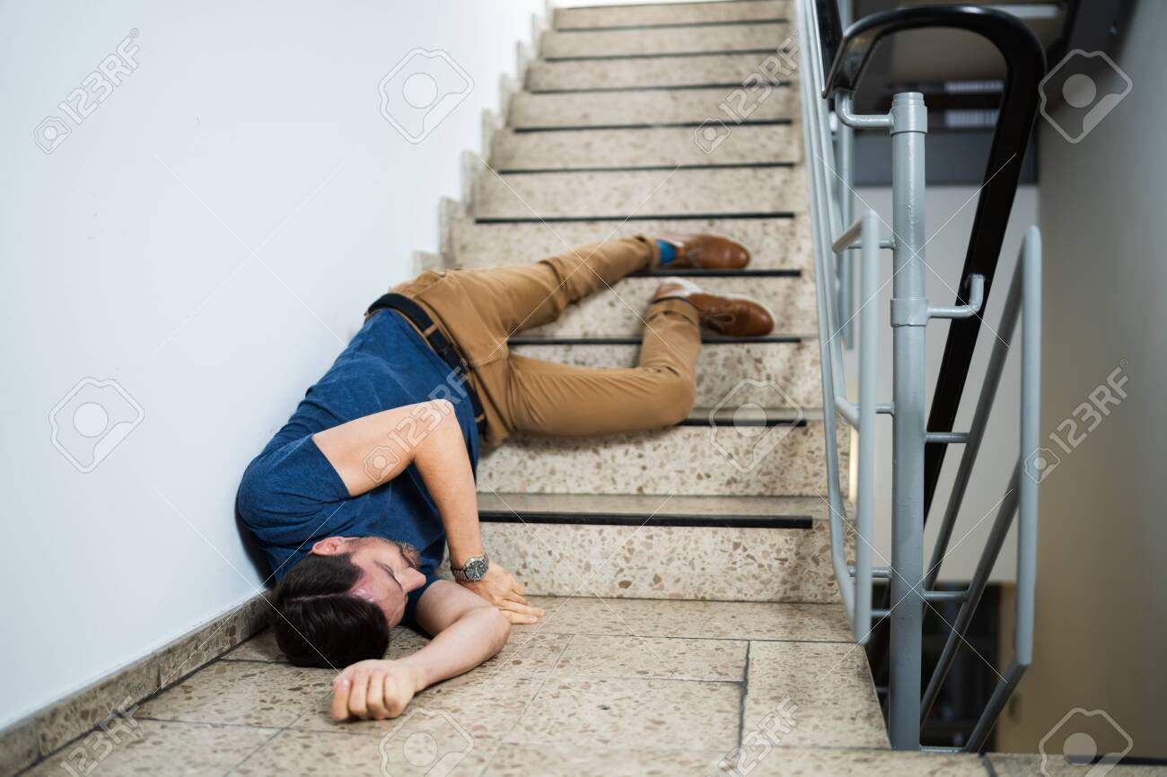 Unconscious Man Lying On Staircase After Slip And Fall Accident - 135479248