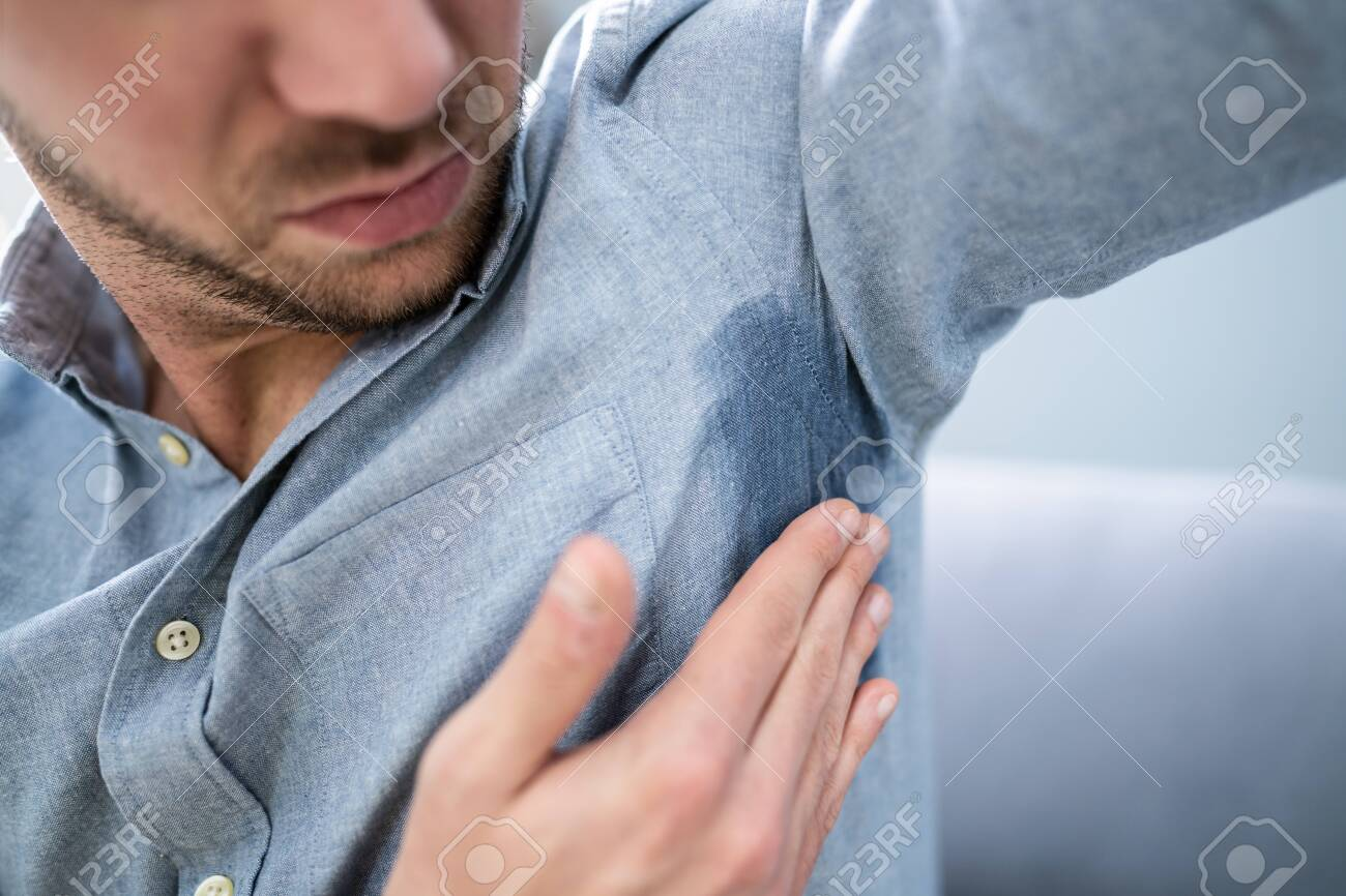 Man With Hyperhidrosis Sweating Very Badly Under Armpit - 137435493