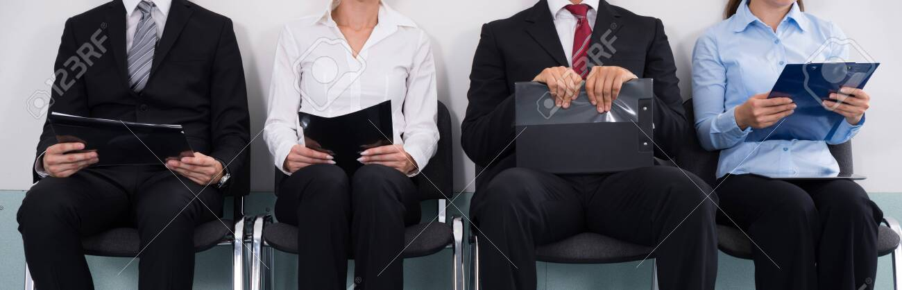 Group Of Businesspeople With Files Sitting On Chair Waiting For Interview - 139825284