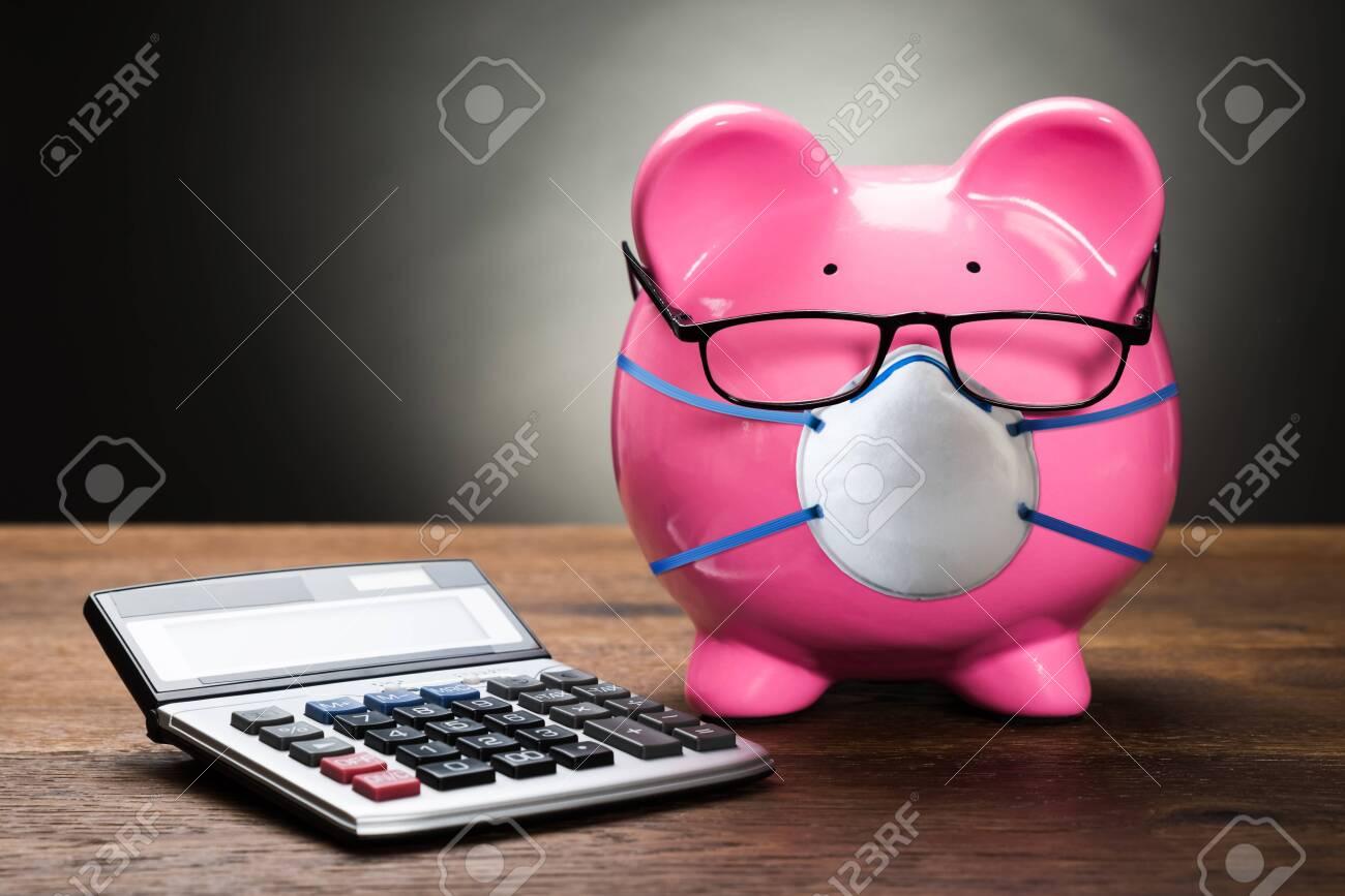 Piggybank With Face Mask During Coronavirus Recession - 142951417
