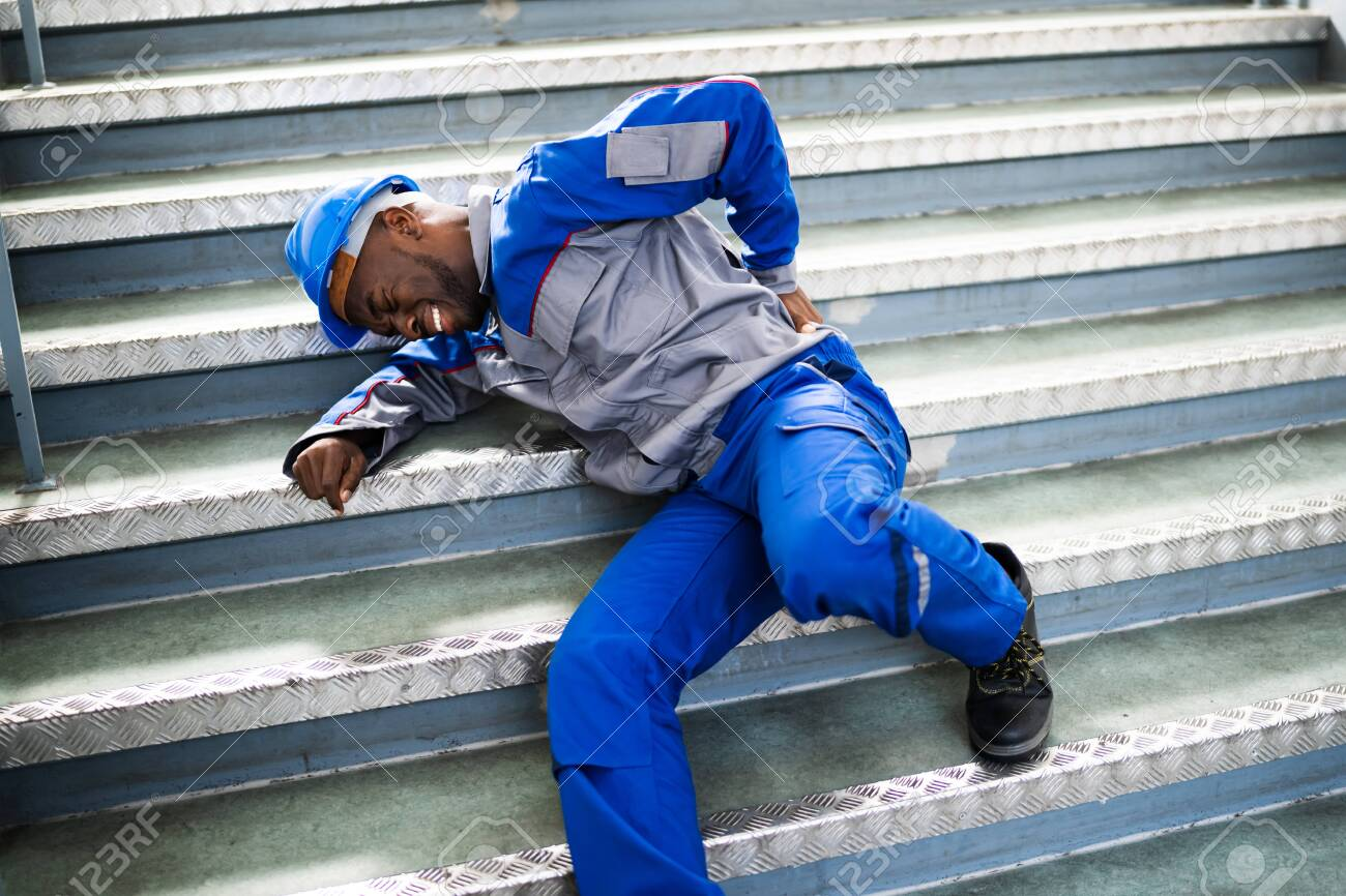 Worker Man Lying On Staircase After Slip And Fall Accident - 143851779