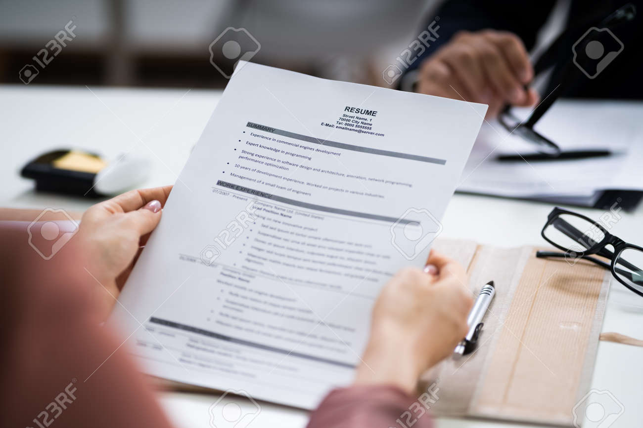 Reading Resume And Recruitment Application At Job Interview - 153116582