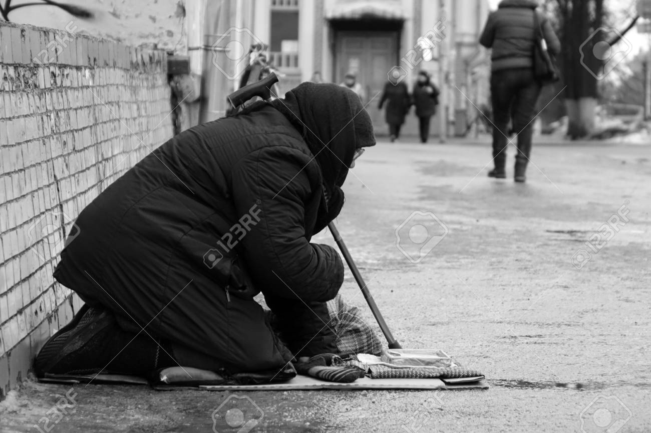 Black and white photo moscow russia january 2018 sad homeless woman sitting on the street people