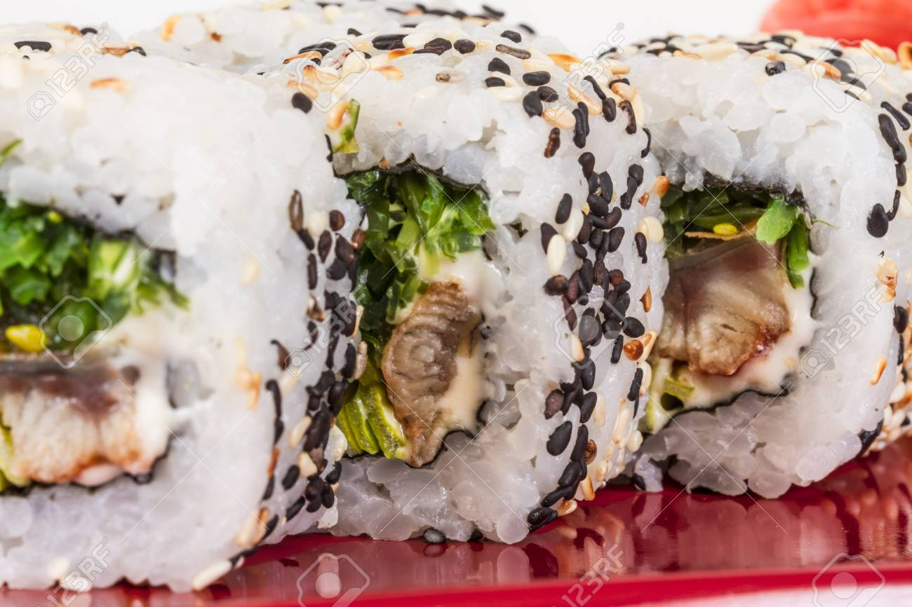 Japanese traditional Cuisine - Maki Roll with Nori , Cream Cheese and Eel. Isolated over white background Stock Photo - 13080512