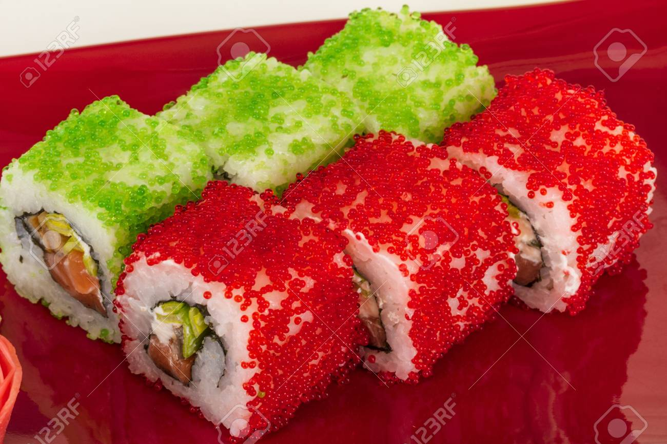 Tobiko Spicy Maki Sushi - Hot Roll with various type of Tobiko (flying fish roe) outside and salmon inside Stock Photo - 13080618