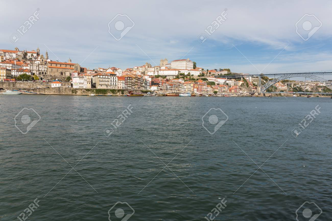 View of Porto city at the riverbank (Ribeira quarter) and wine boats(Rabelo) on River Douro(Portugal), a UNESCO World Heritage City. Stock Photo - 16790461