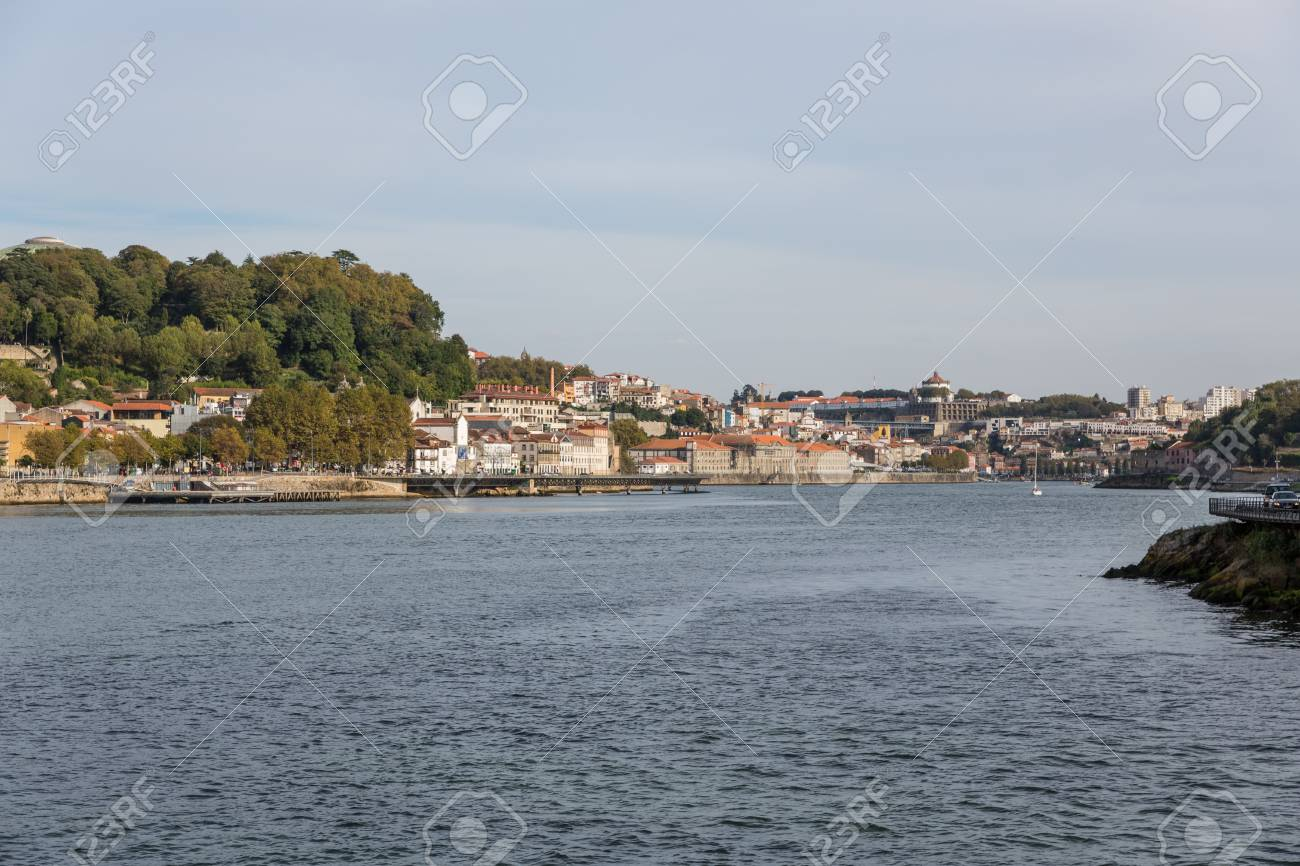 View of Porto city at the riverbank (Ribeira quarter) and wine boats(Rabelo) on River Douro(Portugal), a UNESCO World Heritage City. Stock Photo - 16804892