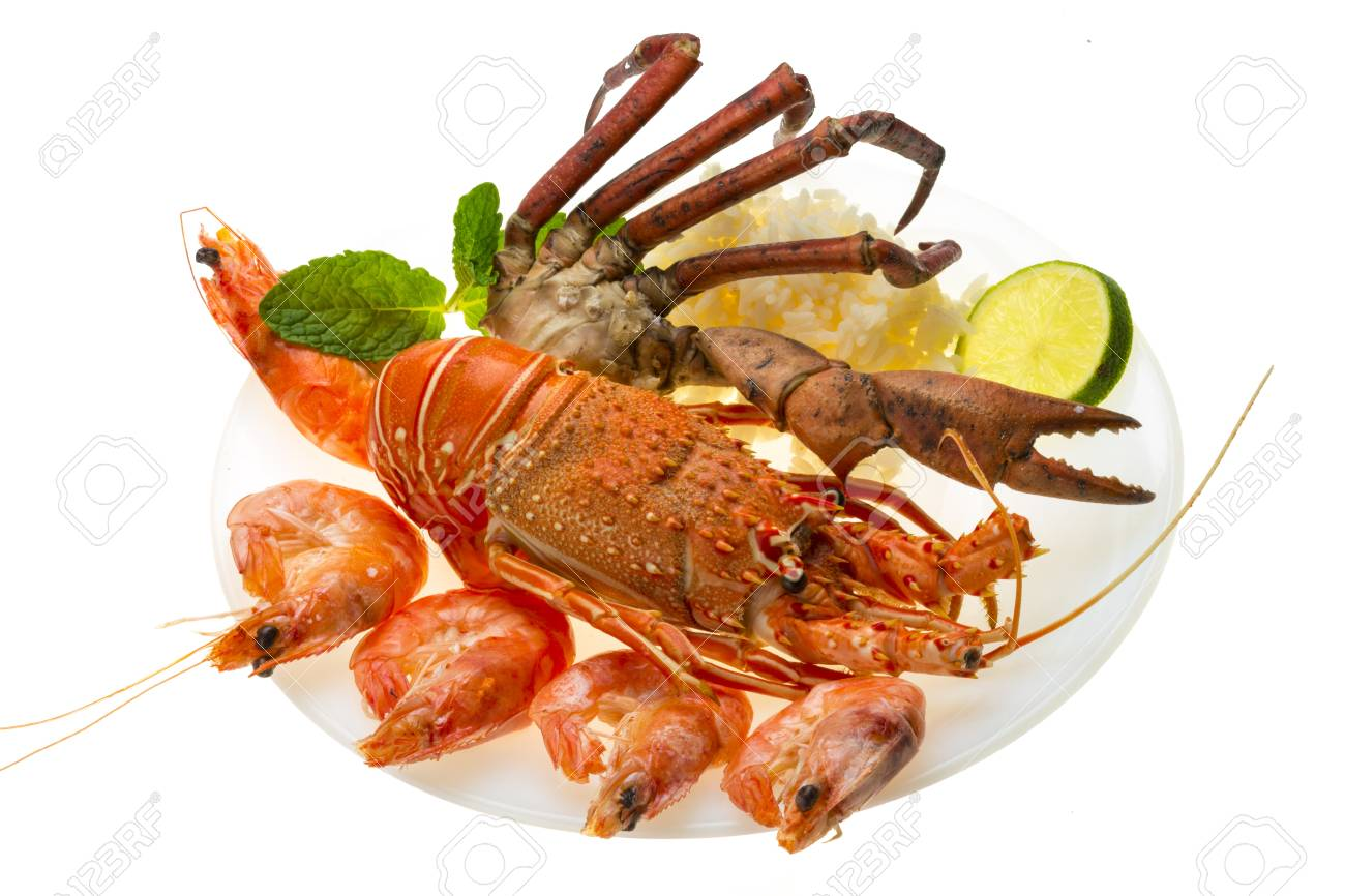 Spiny lobster, shrimps, crab legs  and rice Stock Photo - 19485428