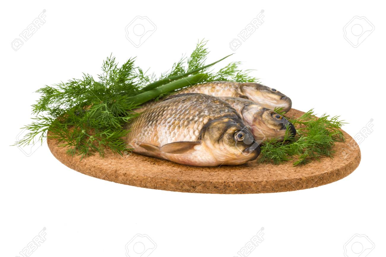 Raw Crucian on the plate with dill Stock Photo - 21228130
