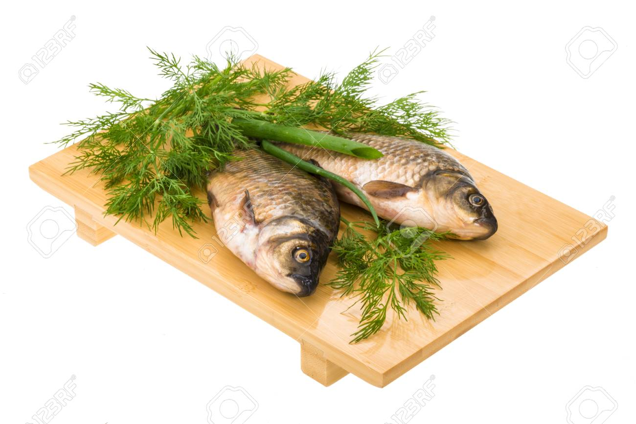 Raw Crucian on the plate with dill Stock Photo - 21228131